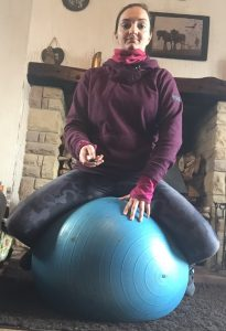 seated straddle on ball